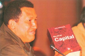 Hugo Chávez, former president of Venezula, holding the Spanish edition of Beyond Capital by István Mészáros