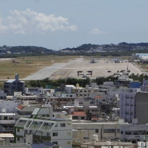 """Osprey military aircraft are seen at the U.S. Futenma airbase in Ginowan, on the southern Japanese island of Okinawa, July 26, 2013. Japan's Prime Minister Shinzo Abe, who took power in December and strengthened his mandate with the LDP's decisive victory in last month's upper-house election, has enjoyed early success because of """"Abenomics"""", a combination of aggressive public spending and monetary easing that has kickstarted economic growth. But with the opposition in disarray and no need to face voters for several years, elements within the LDP are starting to dig in their heels on issues important to Abe's reform agenda, including a multilateral trade treaty. Okinawa, which handed the LDP one of its few defeats in the upper house elections, offers a glimpse of what serious anti-Abe opposition looks like. The LDP's election defeat underlines the importance of Futenma for Okinawa people who believe they bear an unfair burden of the U.S. bases, a legacy of the battle on the island in World War Two and the U.S. occupation that lasted until 1972. Picture taken July 26, 2013. REUTERS/Nathan Layne (JAPAN - Tags: POLITICS MILITARY) - RTX12QBE"""