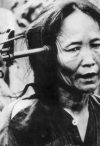 Vietnamese woman with a gun to her head, Vietnam War, 1969 (Keystone / Hulton Images / Getty)
