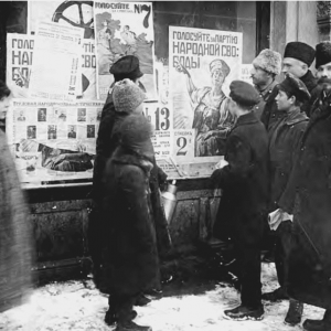 Petrograders examine campaign posters for elections to the Constituent Assembly