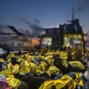 Syrian refugees on an Italian navy ship after being rescued