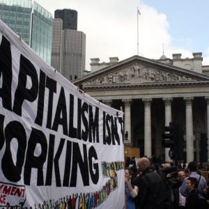 """Capitalism Isn't Working."" Photo credit: Jonny White / Creative Commons."