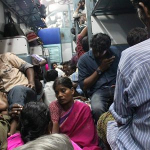 Migrant workers returning home in a train in Cochin, India.