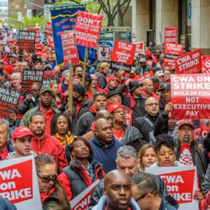 2,000 Verizon workers on strike, supporters & elected leaders march to Verizon Wireless office, Wall Street, NYC (Photo, Erik Mc Gregor/Pacific Press)