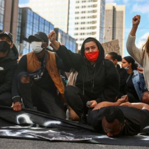 Demonstrators gesture as they attend a protest against police brutality and the death in Minneapolis police custody of George Floyd, in Frankfurt, Germany, June 6, 2020