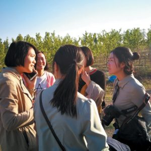 Local staff members of Puhan cooperatives in the field