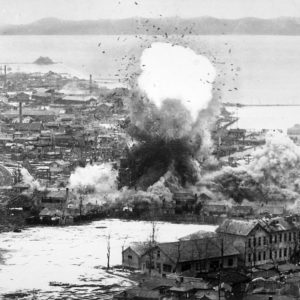Para-demolition bombs being dropped on supply warehouses and dock facilities at a port in Wonsan, North Korea by the Fifth Air Force's B-26 Invader light bombers (ca. 1951)