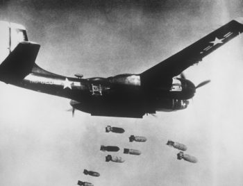 A black painted U.S. Air Force Douglas B-26C Invader dropping bombs during the Korean War in 1953