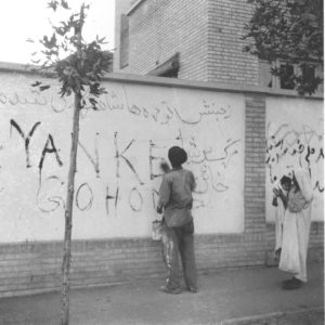 Tehran resident washes graffiti off wall, Aug. 21, 1953. The new Premier requested the clean-up after US coup